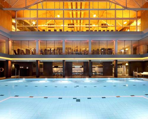 The striking 23m indoor pool is visible throughout the club