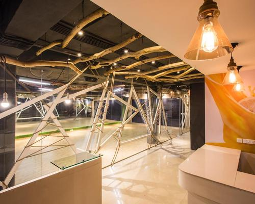 To create a 'contemporary, yet rugged' look, treated wooden branches have been suspended from the ceilings / Studio Ardete