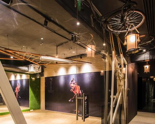 Bicycles are suspended from the ceiling to promote the idea of activity / Studio Ardete