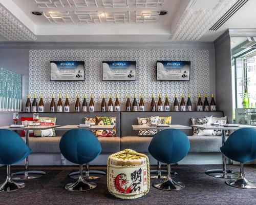 The restaurant is designed as a retro-futuristic, otherworldly scene, with European design features combined Andy Warhol-style art work  / Blue Sky Hospitality