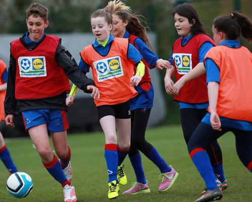 The aim is to have 200,000 more youngsters playing football by 2024