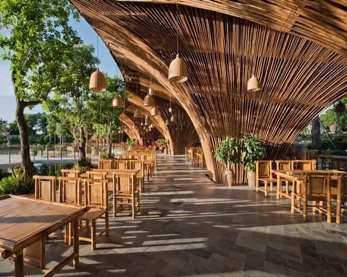 Roc Von restaurant is formed of 12 huge bamboo columns which spread upwards, creating a canopy that covers a semi-outdoor dining area. 