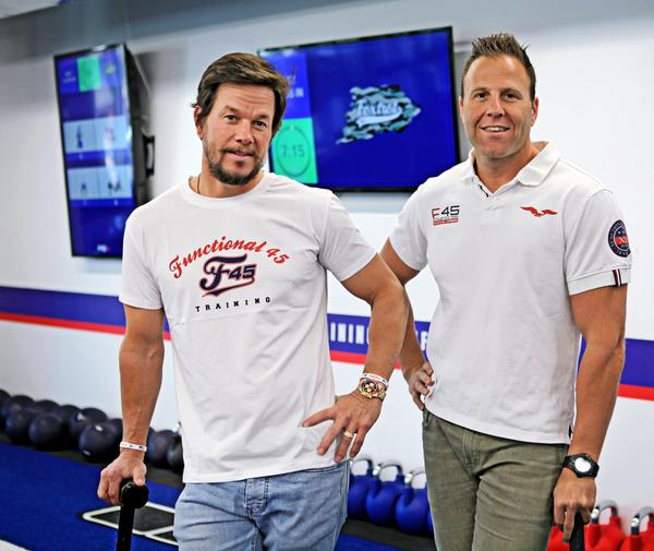 Wahlberg, here with CEO Rob Deutsch, is expected to draw on his passion for fitness to drive the growth of F45