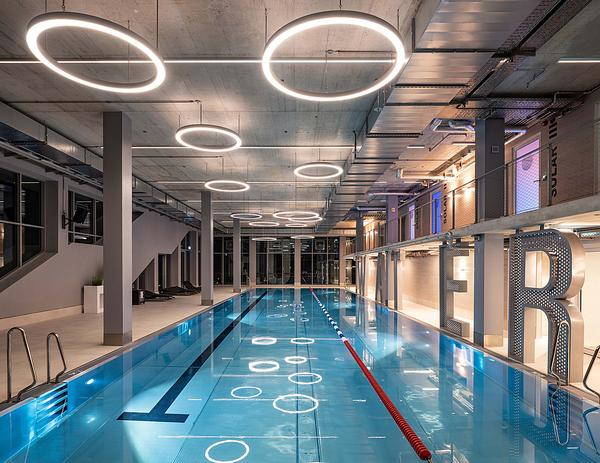 The building features a three storey gym with a pool. The 5m high lettering can be seen from inside and outside of the complex