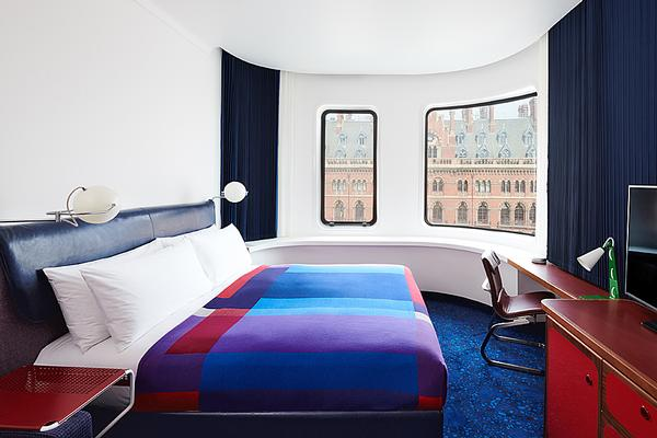 The bedrooms feature cushioned window seats and bright colours