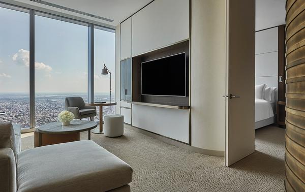 The guestroom interiors are by Foster + Partners
