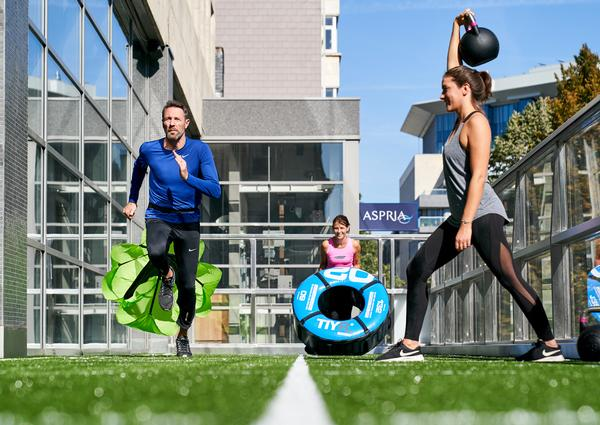 The outdoor terrace at Aspria features turf with markings to show the different workout zones