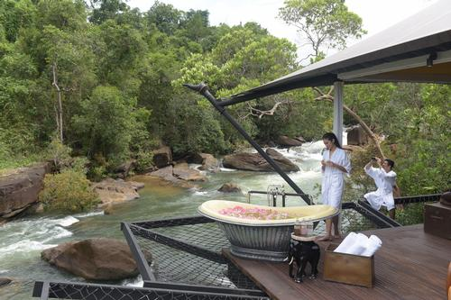 Guests access the resort by using a zip-line to 'fly' over river rapids and a waterfall. / Courtesy of Shinta Mani Hotels & Resorts