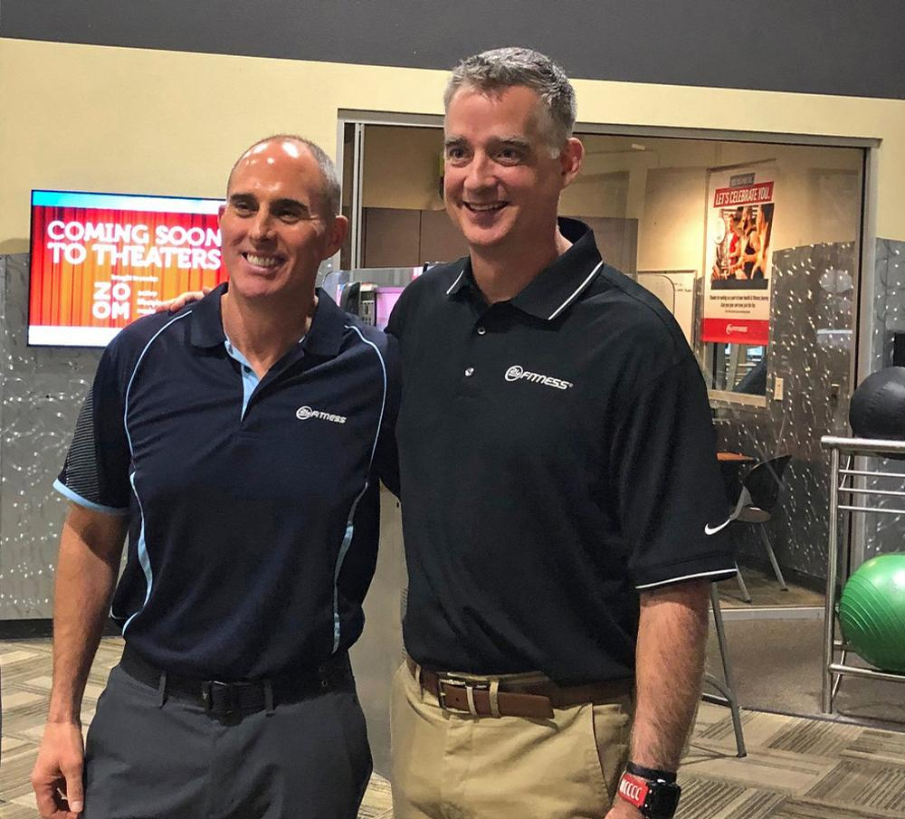 Outgoing CEO Chris Roussos (left) with new chief executive Tony Ueber / 24 Hour Fitness