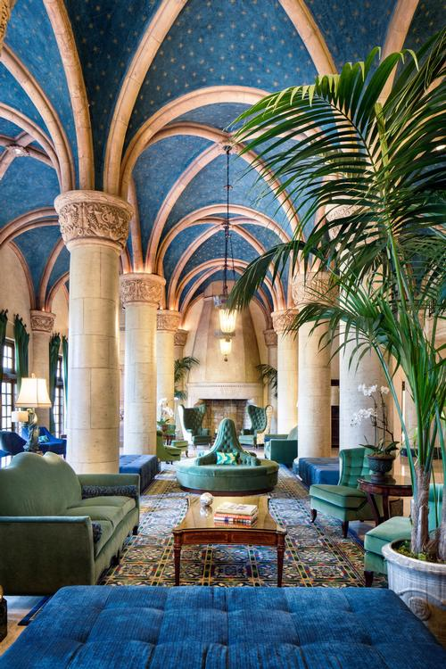 The main lobby, with its arched vaults, ornate columns, and tropic-themed interiors is a premier example of architectural eclecticism. / Courtesy of The Biltmore Hotel