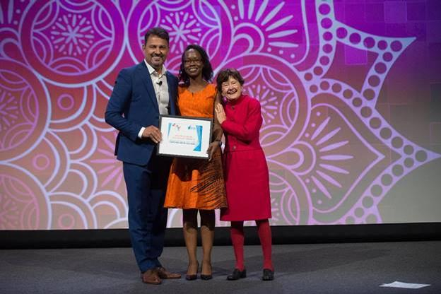 2018 Mary Tabacchi Scholarship winner, Christine Muchemu, was honoured onstage at the 2018 ISPA Conference & Expo alongside Frank Pitsikalis, chair of the ISPA Foundation and Dr Mary Tabacchi