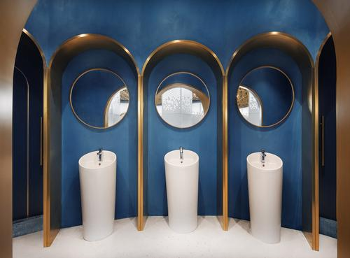 Porthole-shaped mirrors appear throughout the restaurant. / Courtesy of Topos Design Clan