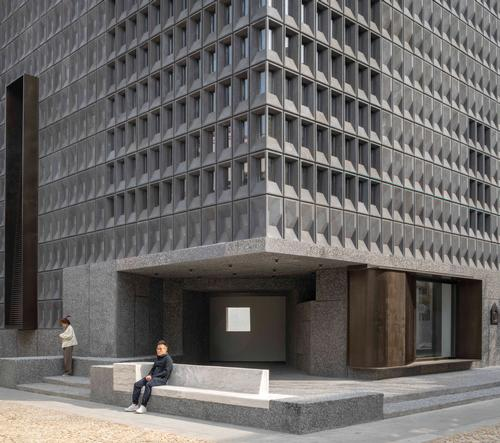 The neo-Brutalist structure is composed of