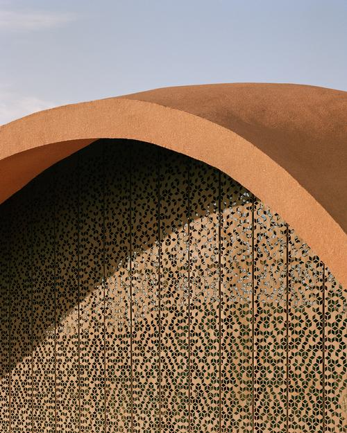 Screen filters on the building are inspired by mashrabiya windows / Oppenheim Architecture
