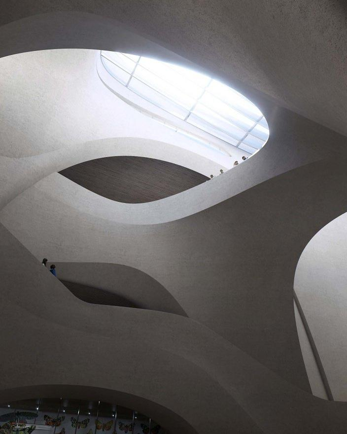 A vast skylight from above will brighten the central exhibition hall with its undulating arches of reinforced concrete / Studio Gang