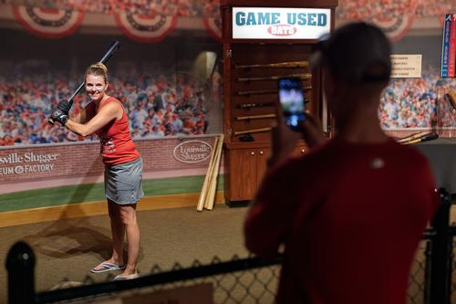 Visitor can pose with game-used bats