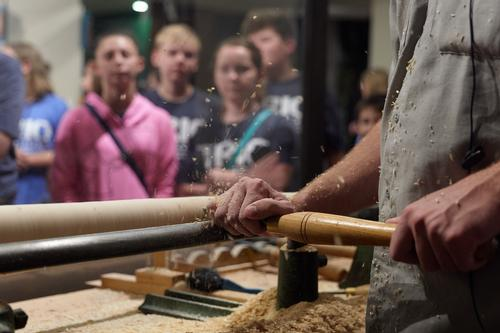 An audience for the demonstration of traditional hand-turning skills