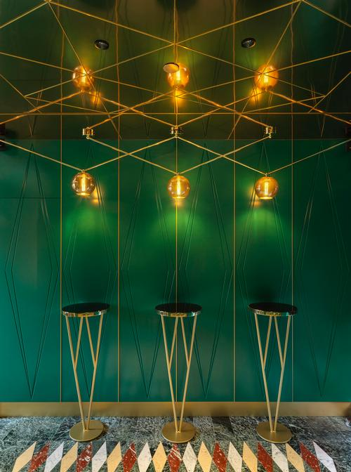 A green and gold theme is pulled through the restaurant / Matteo Piazza
