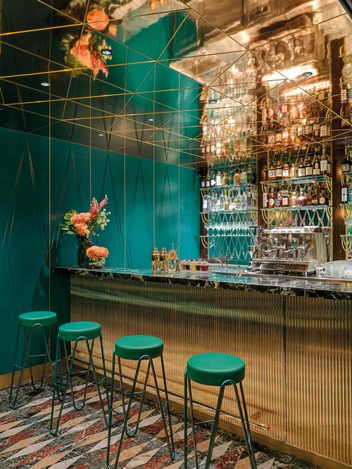 Polished brass and green Alpi marble are used for the bar counter / Matteo Piazza