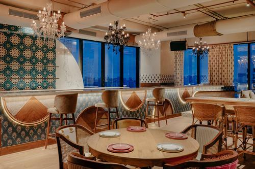 The restaurant has a large backlit bar / Darshan Savla