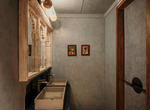 The earthy design theme is drawn through into the toilets / Darshan Savla