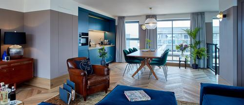 The living space in one of the penthouse apartments / Native