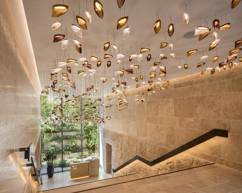 The travertine-lined lobby has a bespoke Lasvit chandelier