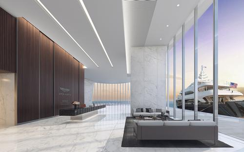 There are floor-to-ceiling windows in the lobby / Aston Martin