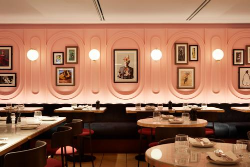 The restaurant and bar space has an Art Deco-inspired aesthetic / SODA Studio