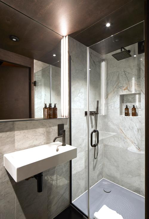 The guest room bathrooms each have a walk-in shower / Edmund Sumner