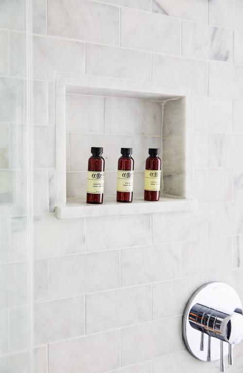 Bathrooms feature marble baths and rain showers / Read McKendree