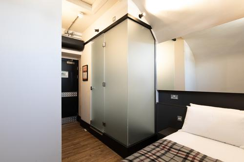 The varied configuration of spaces in the building was actually well-suited to hostel use / Jeff Manson