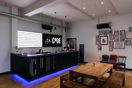 Painted bare walls throughout the building recall its former use / Code Pod Hostels