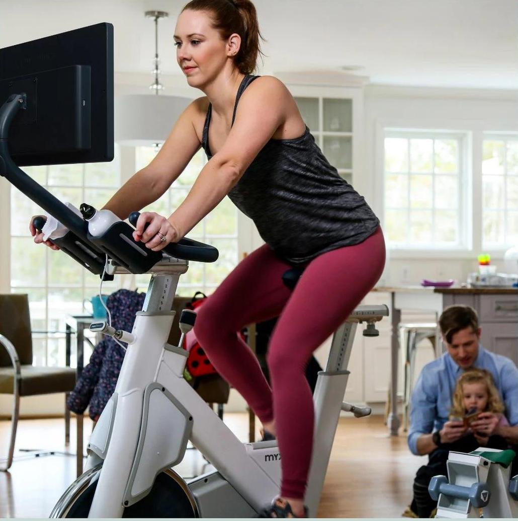 MYXfitness' package includes a commercial-grade Star Trac Stationary Bike Trainer fitted with a 21.5-inch interactive tablet / MYXfitness