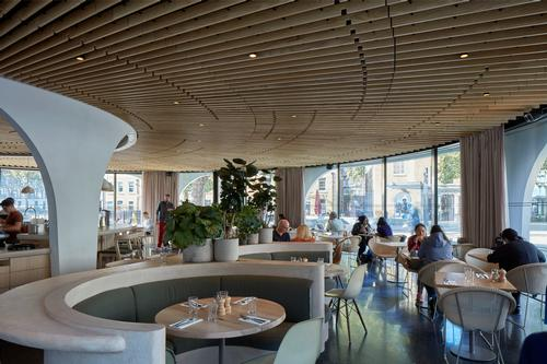 the interior features wooden fixtures, an ash slatted ceiling and terrazzo flooring / James Brittain