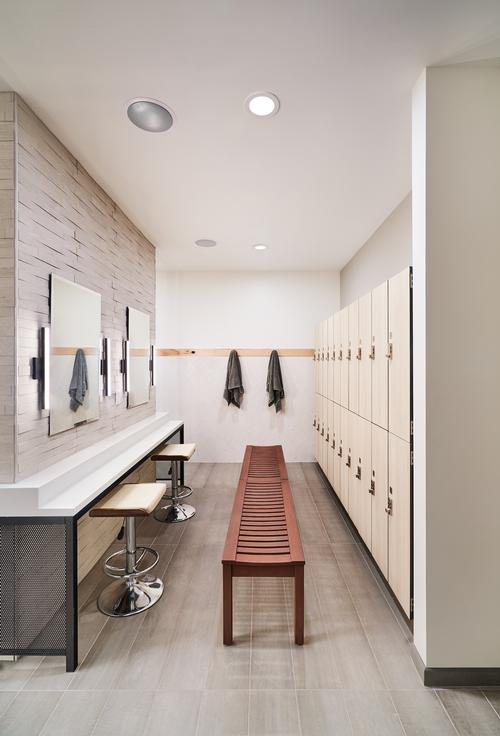 The changing areas have high-quality fixtures and bright lighting / Hufft