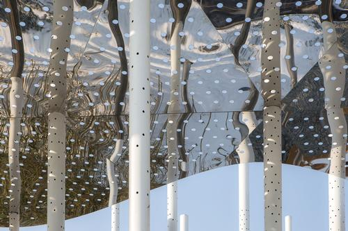 Perforations in the canopies create an interplay of light and shadow as the conditions change and time passes / Aurelien Chen