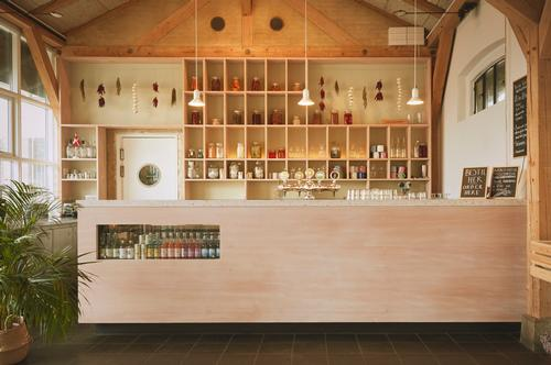 Large furniture pieces like the bar, hanging table, accompanying benches and booths were all made from the Douglas fir / Vermland