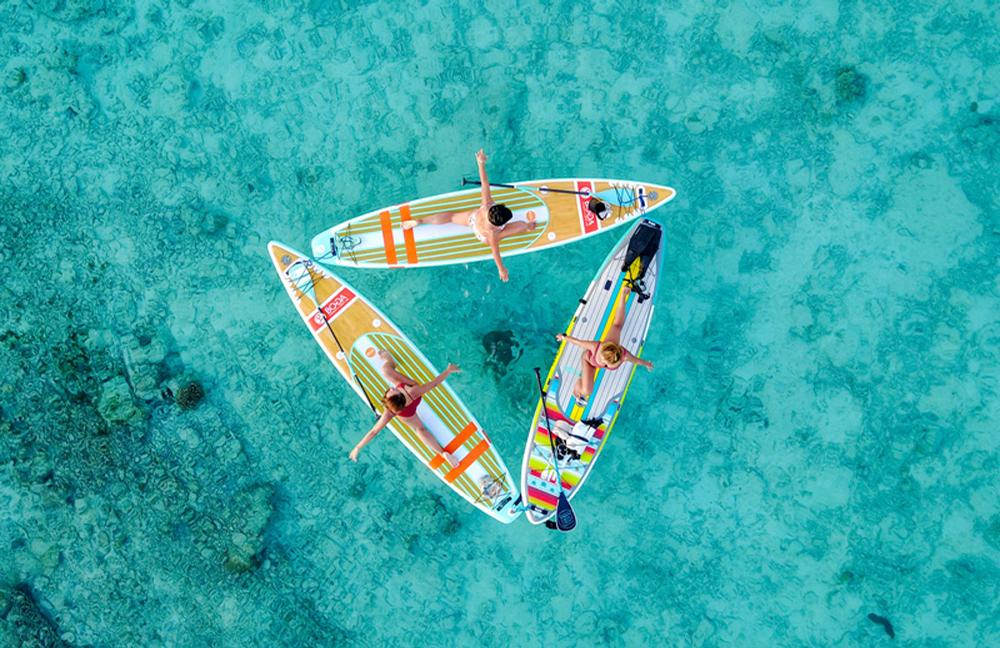 Floating yoga uses stand-up paddleboards to provide a demanding workout / Coco Bodu Hithi