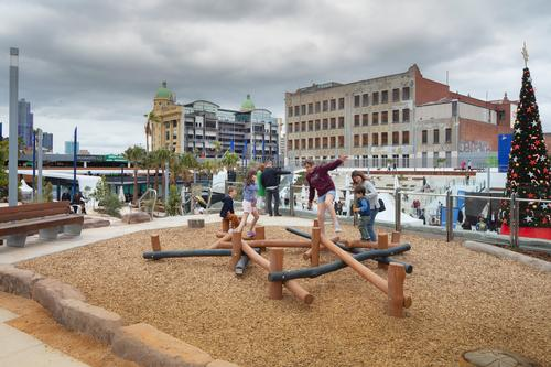There are activity spaces for children around the square / John Gollings