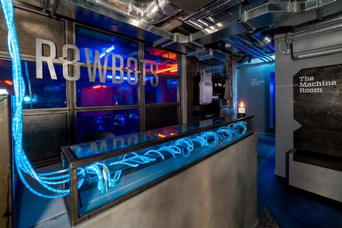 Lighting consultants Nulty complemented the aesthetic with a mix of neon blue and amber strip lights and LED cables in and around the main exercise space / Jim Catlin Photography