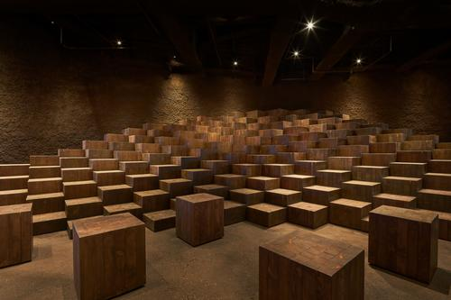 The events space has terraced seating that is reminiscent of paddy fields / Daici Ano