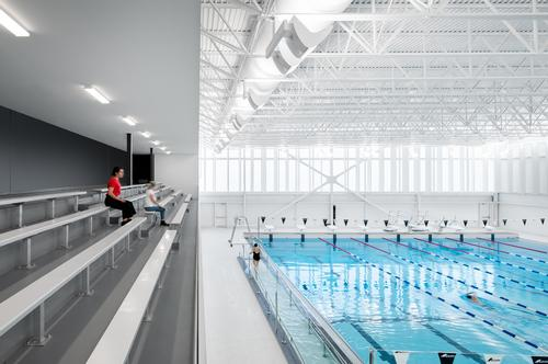 The competition pool features bleacher seating / David Boyer