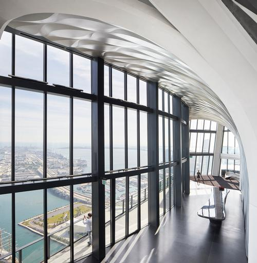 A sky lounge with views of the surrounding areas provides space for relaxing and hosting events / Hufton+Crow
