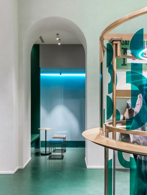 Once descended, the machine provides a counter on which for guests to rest their drinks and a display case for the clothing now contained within / Alessandro Saletta for DSL Studio