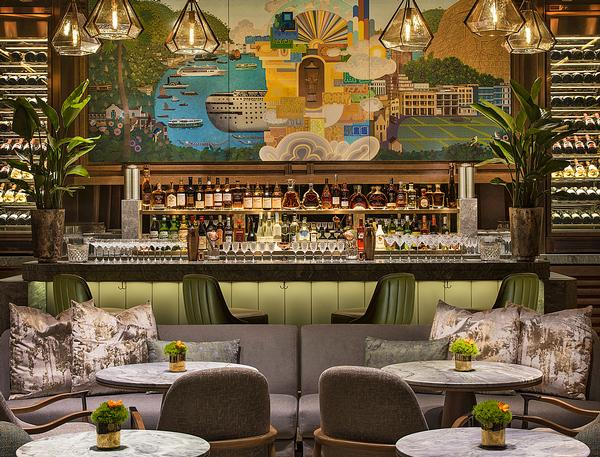 A large mural behind the bar acts as a focal point for the room