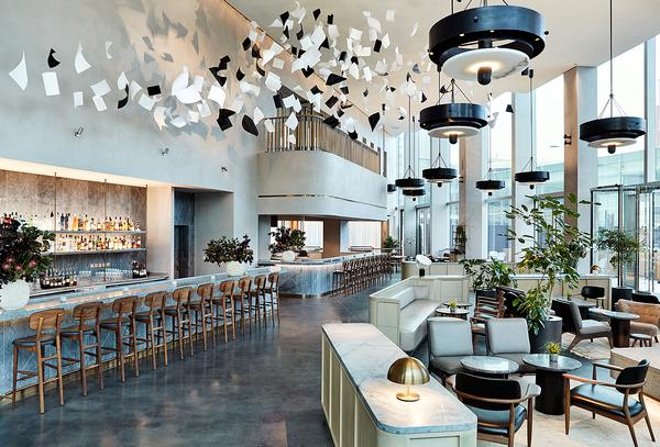 The triple height entry lobby features a brasserie restaurant