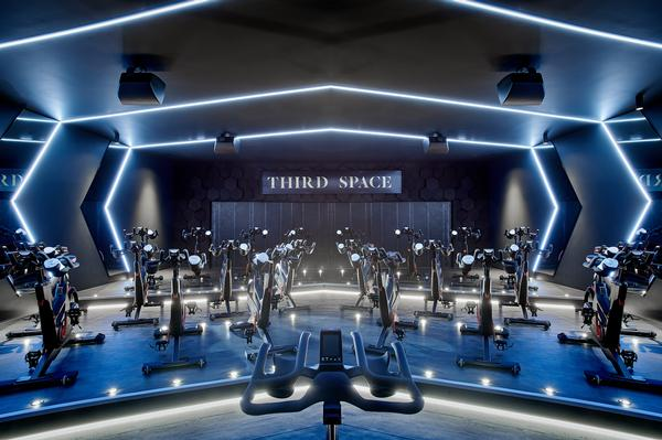 The cycling studio has custom-designed lighting and sound sytems, as well as industrial turbines to create a headwind