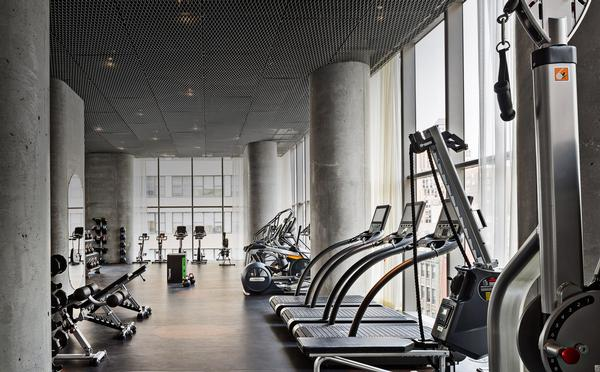 Residential gyms, such as this at 56 Leonard by Herzog & de Meuron in New York City, command a premium