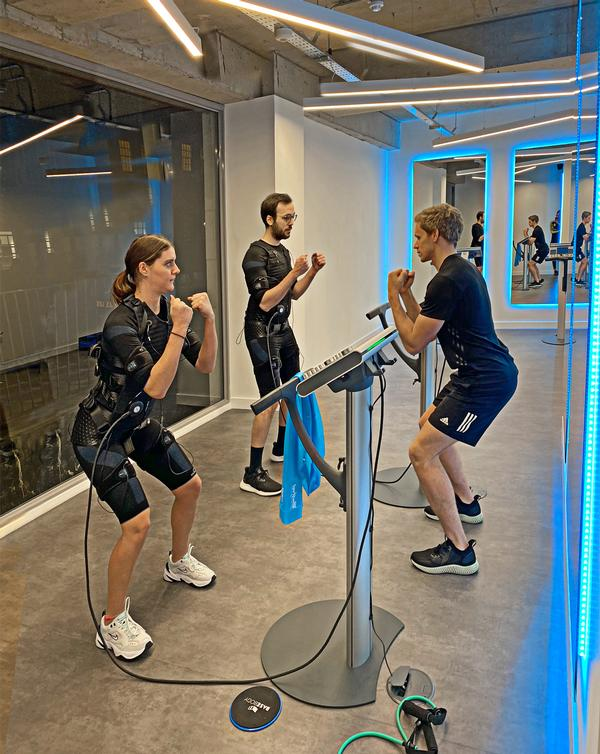 Fraser Smith takes clients through an EMS workout at ViveFitness